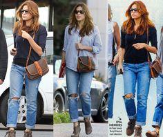 Eva Mendes pairs her chic boyfriend jeans with a Vintage Dooney & Bourke Shoulder bag