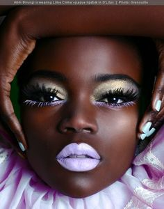 Black woman, beautiful makeup, high fashion shoot. Model Atim Birungi. I love the colours and contrast of her make-up. Beautiful face and eyes. This face is intriguing. Grenouille. French, France.
