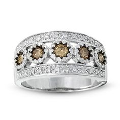 This has a similar look to mine- even though I have floral design but it is the wide bank and champagne diamonds- This ring is lovely too- ms