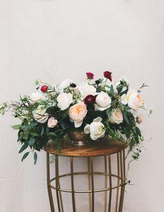 Whimsical floral centerpiece: http://www.stylemepretty.com/living/2015/05/09/17-fabulous-diy-flower-arrangements/
