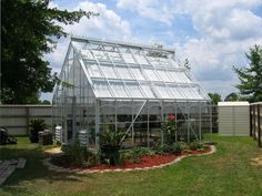 The unique style of a Tradional Cape Cod design adds character to any landscape setting. The heavy aluminum frame and the proven performance of a glass greenhouse covering is guaranteed to provide many hours of gardening enjoyment. Architecturally pleasing, the dramatic roof slope provides a spacious interior. The 45 degree angle of the roof slope maximizes interior height for tall greenhouse plants.