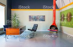 A modern loft space with concrete flooring. The furnishings consist. Modern Loft, Modern Desk, Modern Flooring, Flooring Ideas, Geometric Tiles, Best Desk, Desk Setup, Loft Spaces, Floor Design