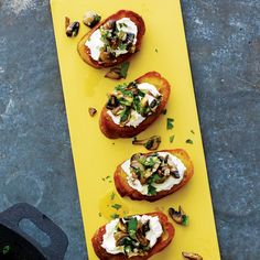 Top bread with goat cheese and a flavorful mushroom mixture to make a tasty appetizer.