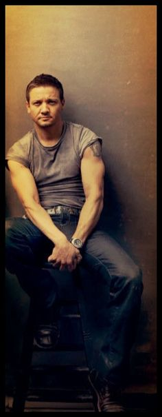 Jeremy Renner arm porn. (Why do shirts even come with sleeves?)