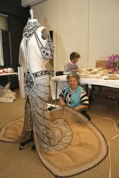Victoria's Secret Fashion Show Readies for the Runway (A beader works on a gown from the Silent Screen Angels venue. )