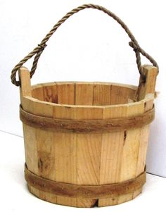 """The wishing well bucket is 11.75″D x 8.5″H with a 10"""" diameter. Used for harvesting fruits and vegetables, a planter, carrying garden tools, and of course, for your wishing well. $42. http://jamaicacottageshop.com/shop/10-wooden-wishing-well-bucket/ http://jamaicacottageshop.com/shop/wishing-well/"""