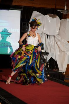 Process Color Prom, by Ali Kosky & AHA! Creative Team. Made of Discard ribbons from thermal printer, grommets, banner material, and vinyl. Created for 2011 Junk2Funk Eco Fashion Show, which features local artists' fashion creations from recycled materials to benefit the Kootenai Environmental Alliance.