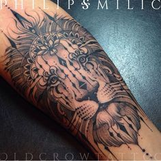 Lion tattoo by Philip Milic.