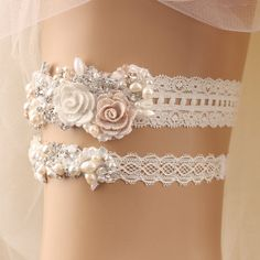 """* Gorgeous wedding embroidered flowers with beaded lace garter set It's perfect for your special day!  *Size Please measure around thigh with a soft measuring tape and select your thigh measurement from drop down menu. Wedding garters are generally worn roughly 2-5"""" above the knee to around mid-thigh. *Color& Materials -Off white elastic lace band -Embroidered flowers-white, light beige -Beaded lace appliqué, pearls, rhinestones, crystals -Glitter light ivory lace trim -Light blue ribbon ..."""