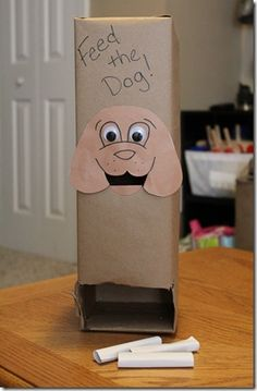 Toddler Activity - Feed the Dog: Pretoddlers love taking things in and out of boxes and other small places.  They also still really like to see things drop.