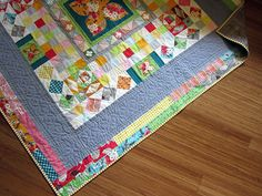 cool quilt with interesting border.  Modern Medallion quilted by StitchedInColor, via Flickr