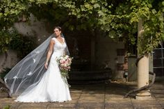 A Beautiful Bride in The Roman Garden at Sedgeford Hall Norfolk Wedding and Event Venue - Holiday Cottages