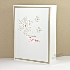 Sparkling snowflakes are falling gently on this handcrafted Christmas or Winter Seasonal greeting card.  Soft browns, crisp white and a hint of red blend perfectly to create a clean and simple design