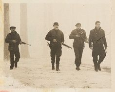 """Members of the Howling Commandos. From left to right: Cpl. Jacques """"Frenchie"""" Dernier, Cpl. Timothy Alyosius """"Dum Dum"""" Dugan, Lt. James Montgomery Falsworth, Sgt. James Buchanan """"Bucky"""" Barnes (Poland, February 1944)."""