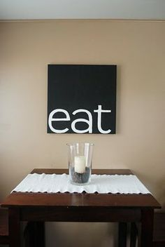 Simple but cute. I would paint canvas black and center wooden letters painted white.