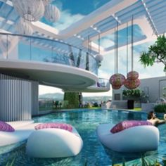 There is a little bit of an odd quality to the architecture, but I like the balcony/patio thing and the floaty things in the pool. Future House, Luxury Pools, Luxury Condo, Luxury Houses, Dream Pools, Beautiful Pools, House Goals, Pool Designs, My Dream Home