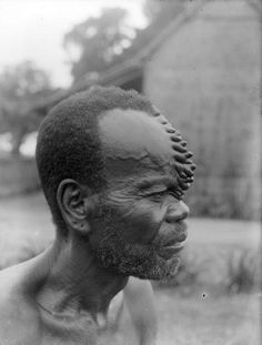 Africa | A Boko man, from the DR Congo,  with characteristic 'cockscomb' scarification that was obtained by carving the same places several times. | © Auguste M. Bal