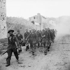 British troops escorting German prisoners through the town of Vietri, Italy, 24 September 1943.