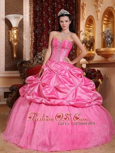 Modest Rose Pink Quinceanera Dress Sweetheart Taffeta Beading Ball Gown  http://www.fashionos.com  The pink quinceanera dress features a strapless bodice which is decorated with carefully placed beadings and a sweetheart neckline. The skirt is fitted and it adorned wih many pick ups, creating a lovely silhouette. Just a very flattering design for any body shape or style.