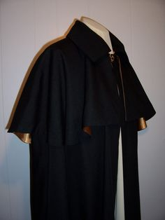 A men's overcoat with attached cape from the 1840's.