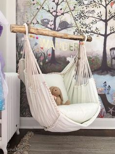 This hammock chair and woodland wall mural wallpaper are wonderful design ideas for a baby nursery, kid's room or playroom - Unique Nursery and Children's Room Decor - KindredVintage Co. Summer Tour Enchanted Forest Mural is from Anthropologie, #kidsroomideasunique