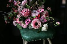Spring flowers by Amy Merrick, love the dogwood flowers and hellebores, so lovely!