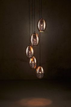 A cascading collection of delicately perforated nickel shades with a warm gold interior Industrial Style Lighting, Industrial Pendant Lights, Pendant Lighting, Chandelier, Gold Interior, Constellations, Lighting Design, Light Bulb, Pendants