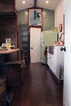 This retro-style kitchen includes a 50s style refrigerator, copper farm sink, and an electric range.