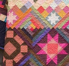 """No one will guess that this stunning quilt was simple to sew! Your Amish With A Twist II Quilt Kit includes a detailed Nancy Rink pattern and lushly-hued Centennials Solids fabric, to sew this gorgeous, king-sized quilt top.  Inspired by classic Amish blocks and color palettes, this 105"""" x 105"""" design will help you develop your strip-piecing skills and make Flying Geese faster than ever."""