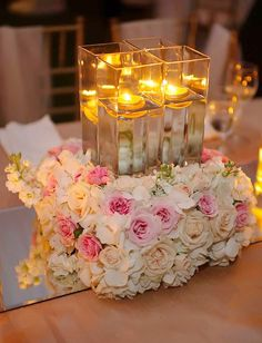 sophisticated floating candle wedding centerpiece ideas with flowers