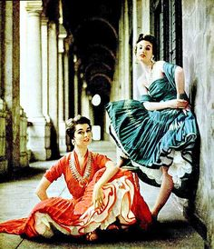 Indian figures are printed on cotton cocktail dresses by Jerome of Arizona and worn with Navajo jewelry by Clay Smith, Photo by Milton Greene, 1953