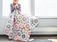 """Give these classic 1930's prints a modern twist! The Hopscotch pattern combines quick and easy 9-patch blocks with fresh sashing blocks, for a darling finished project. The 2 1/2"""" strips included in the kit allow you to play around with the fabrics, creating the perfect scrappy look. Add an Aurifil color coordinating thread box to get a perfect-match stitch!"""