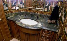 Powder room vanity top in Bamboo Green with custom radius and ogee edge