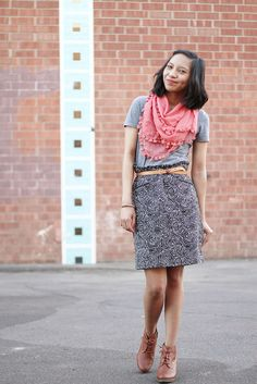 i love this coral scarf against the muted greys