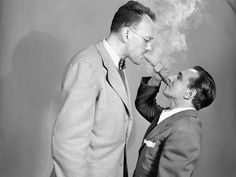 "George Braunsdorf (left) at 6 feet 4 inches demonstrates how to use a ""Double Ender"" pipe with Joe Damone, 5 feet 1 inch, in New York on June 2, 1949. Probably not the best thought out invention..."