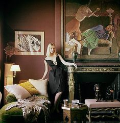 Nico in silk organza cocktail dress with deep plunging neckline by Jules Crahay for Nina Ricci, photographed by Mark Shaw in decorator Henry Samuel's house with his two dachshunds sitting on a stool,  Paris1960   by skorver1