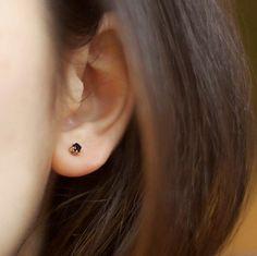 Black stud earrings.