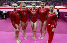 Members of team Canada, Elsabeth Black (L-R), Dominique Pegg, Kristina Vaculik, Brittany Rogers and Victoria Moors stand together during the women's gymnastics team final in the North Greenwich Arena at the London 2012 Olympic Games July 31, 2012.