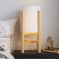Give your decor a stylish touch with this stunning wooden table lamp. Delicately crafted with four wooden legged base, this simplistic table lamp features a white woven paper shade with taped edged finish. A simplistic design to suit any interior. Lolo Wood, Wooden Table Lamps, Paper Table, Wooden Diy, Lamp Design, Wood Furniture, Furniture Ideas, Ladder Decor, Home Decor