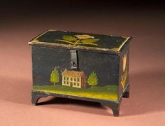 Painted Trinket Box----- In the classic style of Jonas Weber, the front of this box is decorated with a house and two trees. Tulips are depicted on the side and top. The four bracket feet are each carved separately and pegged on from the bottom. This particular example shows outstanding execution and retains great foot height. Visit davidwheatcroft.com