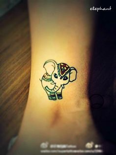 a little well decorated elephant tattoo on the leg #elephant #tattoo