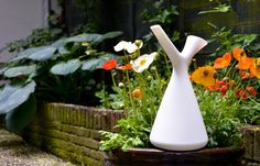 Watering-can by Robert Bronwasser. The Spring is available in yellow, green, baby blue and light grey.