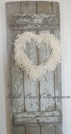 """barn doorheart wreath from White Lace Cottage. Not sure if I can find that """"dizzy frizzy"""" yarn she speaks of though."""