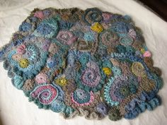 Here is my first piece of freeform crochet wall art, currently hanging in my bedroom.