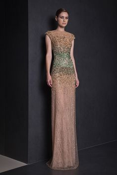 Straight cut Lace dress gradating in shades of green and Gold embroidered Tulle with a round neckline and cap sleeves.