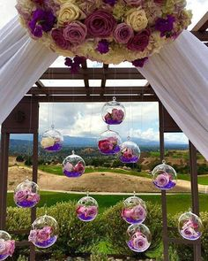 Glass spheres with lavender roses hang from an altar structure