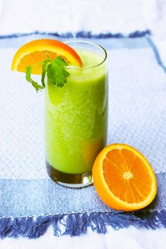 Tropical Cilantro Smoothie by thekitchn: In addition to tasting like a cup of vacation, this simple recipe is packed with wholesome nutrients that will leave you feeling energized and well. Cilantro is a powerful bonding agent that binds to accumulated heavy metals and toxins in vital organs and tissues and aids in their ..... #Smoothie #Cilantro #Pineapple #Banana #Orange_Juice #Healthy