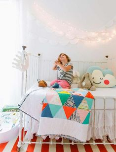 Cute bright quilt in this ecclectic kids room