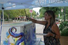 Sarah Kuhn of Windsor paints a piano for the Piano About Town Program on Thursday in Old Town Square in downtown Fort Collins. The program is part of Art