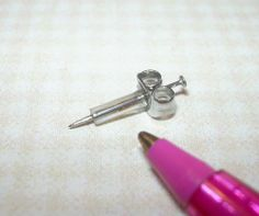 Miniature Realistic (Non-Moving) Syringe Medical Hypodermic 1/12 Scale  No tutorial but clever idea!